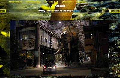 Une projection du papillon jaune Conte-Acteurs a été faite sur l'éléphant des Machines de l'Ile à Nantes.