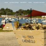 Bourriche d'huîtres Crénéguy et terrasse au bord de l'eau Chez Lucien.